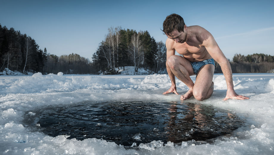 Man going to swim in an ice hole